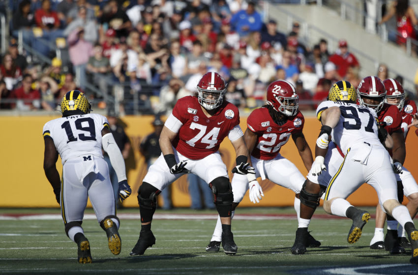 ORLANDO, FL - JANUARY 01: Jedrick Wills Jr. #74 of the Alabama Crimson Tide blocks during the Vrbo Citrus Bowl against the Michigan Wolverines at Camping World Stadium on January 1, 2020 in Orlando, Florida. Alabama defeated Michigan 35-16. (Photo by Joe Robbins/Getty Images)