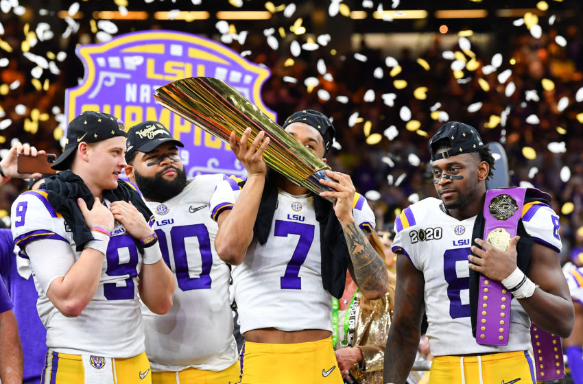 NEW ORLEANS, LOUISIANA - JANUARY 13: Grant Delpit #7 of the LSU Tigers kisses the National Championship Trophy after the College Football Playoff National Championship game at the Mercedes Benz Superdome on January 13, 2020 in New Orleans, Louisiana. The LSU Tigers topped the Clemson Tigers, 42-25. (Photo by Alika Jenner/Getty Images)
