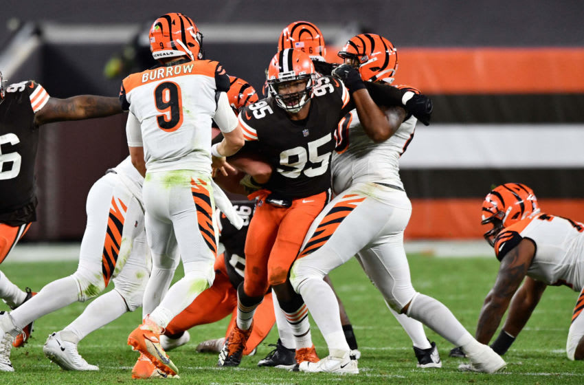 CLEVELAND, OH - SEPTEMBER 17: Myles Garrett #95 of the Cleveland Browns pressures quarterback Joe Burrow #9 of the Cincinnati Bengals in the fourth quarter at FirstEnergy Stadium on September 17, 2020 in Cleveland, Ohio. Cleveland defeated Cincinnati 35-30. (Photo by Jamie Sabau/Getty Images)