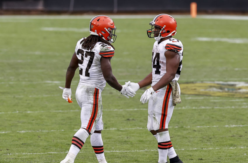 JACKSONVILLE, FL - NOVEMBER 29: Runningbacks Kareem Hunt #27 and Nick Chubb #24 of the Cleveland Browns shake hands after the game against the Jacksonville Jaguars at TIAA Bank Field on November 29, 2020 in Jacksonville, Florida. The Browns defeated the Jaguars 27-25. (Photo by Don Juan Moore/Getty Images)