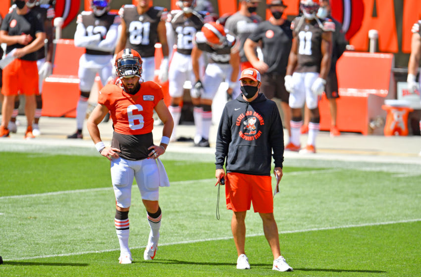 CLEVELAND, OHIO - AUGUST 30: Quarterback Baker Mayfield #6 and head coach Kevin Stefanski of the Cleveland Browns watch a play during training camp at FirstEnergy Stadium on August 30, 2020 in Cleveland, Ohio. (Photo by Jason Miller/Getty Images)