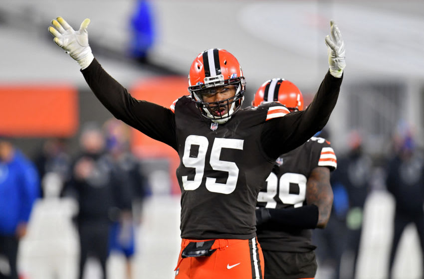 CLEVELAND, OHIO - OCTOBER 11: Myles Garrett #95 of the Cleveland Browns pumps up the crowd in the fourth quarter against the Indianapolis Colts at FirstEnergy Stadium on October 11, 2020 in Cleveland, Ohio. (Photo by Jason Miller/Getty Images)