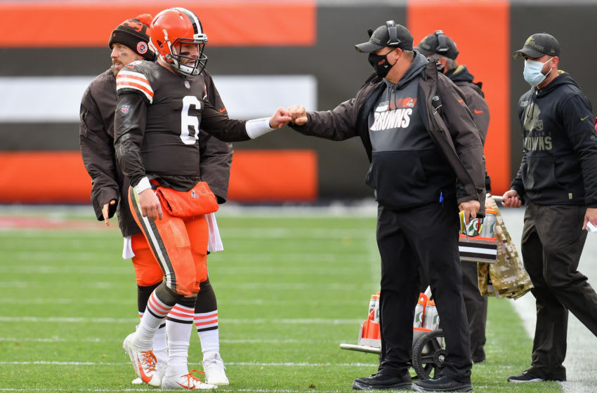 CLEVELAND, OHIO - NOVEMBER 01: Quarterback Baker Mayfield #6 of the Cleveland Browns is greeted by offensive coordinator Alex Van Pelt as he walks off the field during the first half of the NFL game against the Las Vegas Raiders at FirstEnergy Stadium on November 01, 2020 in Cleveland, Ohio. (Photo by Jason Miller/Getty Images)