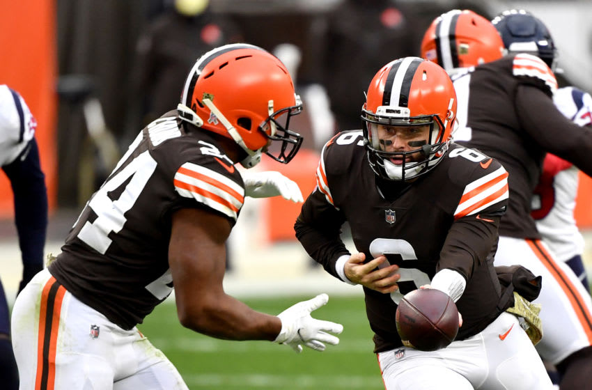 CLEVELAND, OHIO - NOVEMBER 15: Baker Mayfield #6 of the Cleveland Browns hands the ball off to Nick Chubb #24 against the Houston Texans during the second half at FirstEnergy Stadium on November 15, 2020 in Cleveland, Ohio. (Photo by Jamie Sabau/Getty Images)