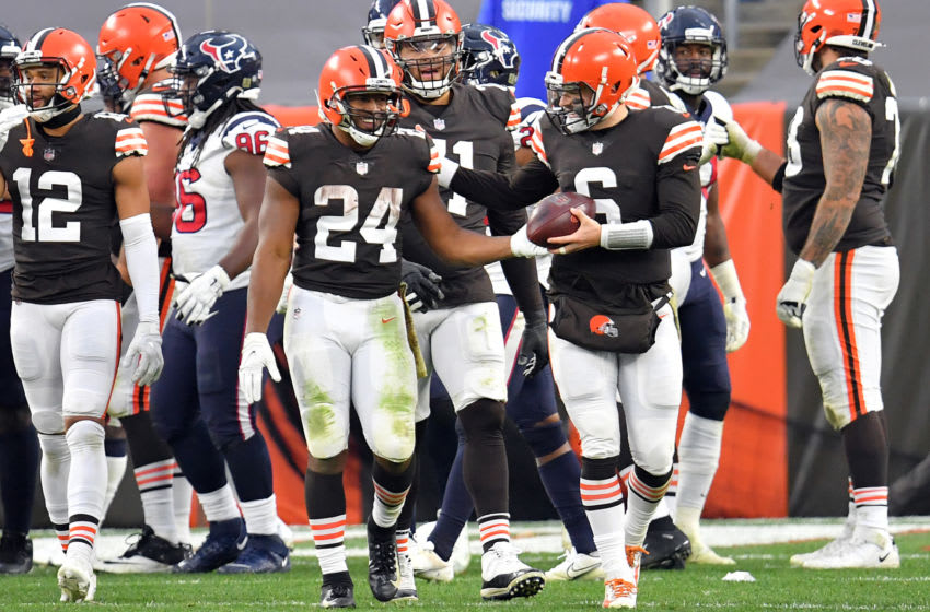 CLEVELAND, OHIO - NOVEMBER 15: Nick Chubb #24 and Baker Mayfield #6 of the Cleveland Browns celebrate the teams 10-7 victory against the Houston Texans at FirstEnergy Stadium on November 15, 2020 in Cleveland, Ohio. (Photo by Jason Miller/Getty Images)
