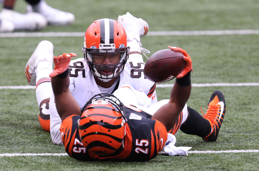 CINCINNATI, OHIO - OCTOBER 25: Giovani Bernard #25 of the Cincinnati Bengals is tackled by Myles Garrett #95 of the Cleveland Browns at Paul Brown Stadium on October 25, 2020 in Cincinnati, Ohio. (Photo by Justin Casterline/Getty Images)