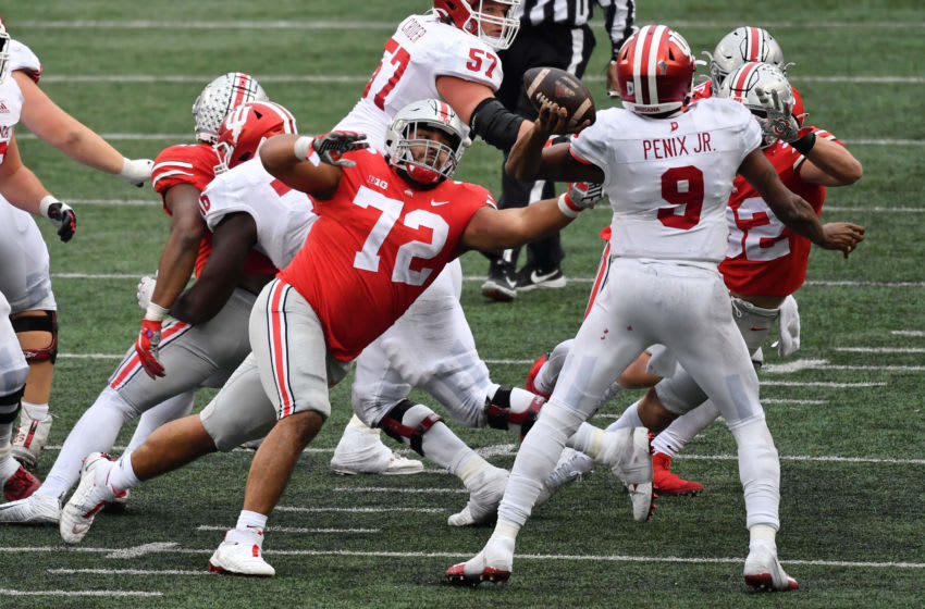 COLUMBUS, OH - NOVEMBER 21: Tommy Togiai #72 of the Ohio State Buckeyes pressures the quarterback against the Indiana Hoosiers at Ohio Stadium on November 21, 2020 in Columbus, Ohio. (Photo by Jamie Sabau/Getty Images)