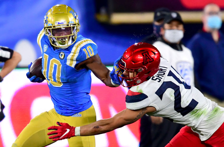 PASADENA, CA - NOVEMBER 28: Running back Demetric Felton #10 of the UCLA Bruins defensive back Jaxen Turner #21 of the Arizona Wildcats as he runs down the sideline during the game at the Rose Bowl on November 28, 2020 in Pasadena, California. (Photo by Jayne Kamin-Oncea/Getty Images)