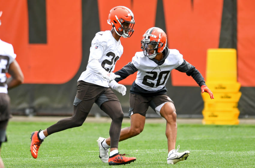 BEREA, OH - JUNE 09: Cornerbacks Greg Newsome II #20 and Greedy Williams #26 of the Cleveland Browns run a drill during an OTA at the Cleveland Browns training facility on June 9, 2021 in Berea, Ohio. (Photo by Nick Cammett/Getty Images)