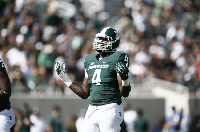 EAST LANSING, MI - SEPTEMBER 27: Malik McDowell #4 of the Michigan State Spartans during the fourth quarter of the game against the Wyoming Cowboys at Spartan Stadium on September 27, 2014 in East Lansing, Michigan. (Photo by Rey Del Rio/Getty Images)