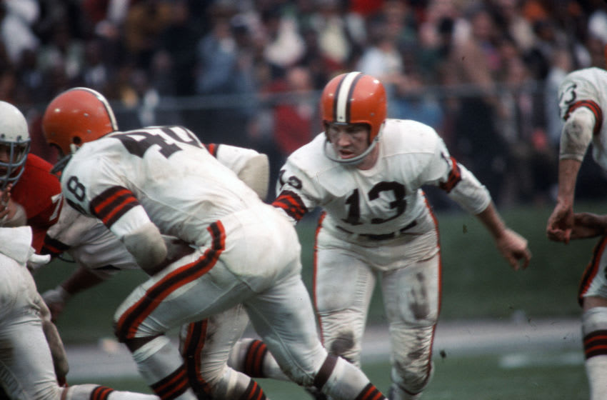 ST. LOUIS, MO - DECEMBER 1: Frank Ryan #13 of the Cleveland Browns hand the ball off to Ernie Green #48 against the St. Louis Cardinals during an NFL football game December 1, 1963 at Busch Stadium in St. Louis, Missouri. Ryan played for the Browns from 1962-68. (Photo by Focus on Sport/Getty Images)