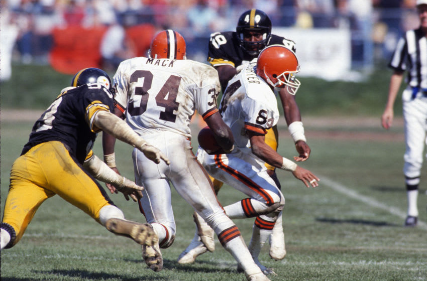 CLEVELAND, OH - SEPTEMBER 20: Kevin Mack #34 of the Cleveland Browns carries the ball against the Pittsburgh Steelers during an NFL Football game September 20, 1987 at Cleveland Municipal Stadium in Cleveland, Ohio. Mack played for the Browns from 1985-93. (Photo by Focus on Sport/Getty Images)