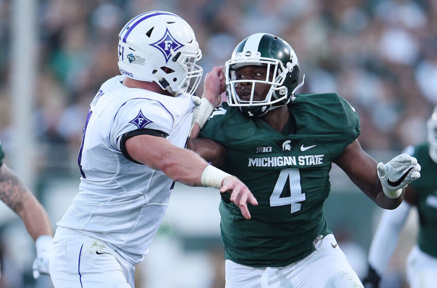 EAST LANSING, MI - SEPTEMBER 02: Malik McDowell #4 of the Michigan State Spartans works against Harrison Monk #71 of the Furman Paladins during the first half of a game at Spartan Stadium on September 2, 2016 in East Lansing, Michigan. (Photo by Stacy Revere/Getty Images)