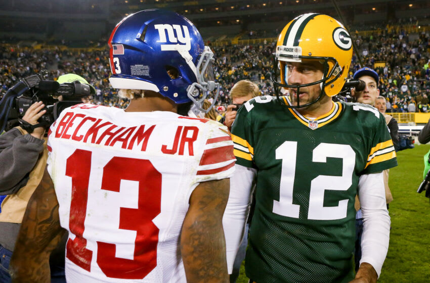 GREEN BAY, WI - OCTOBER 09: Aaron Rodgers #12 of the Green Bay Packers meets with Odell Beckham Jr. #13 of the New York Giants after the game at Lambeau Field on October 9, 2016 in Green Bay, Wisconsin. (Photo by Dylan Buell/Getty Images)