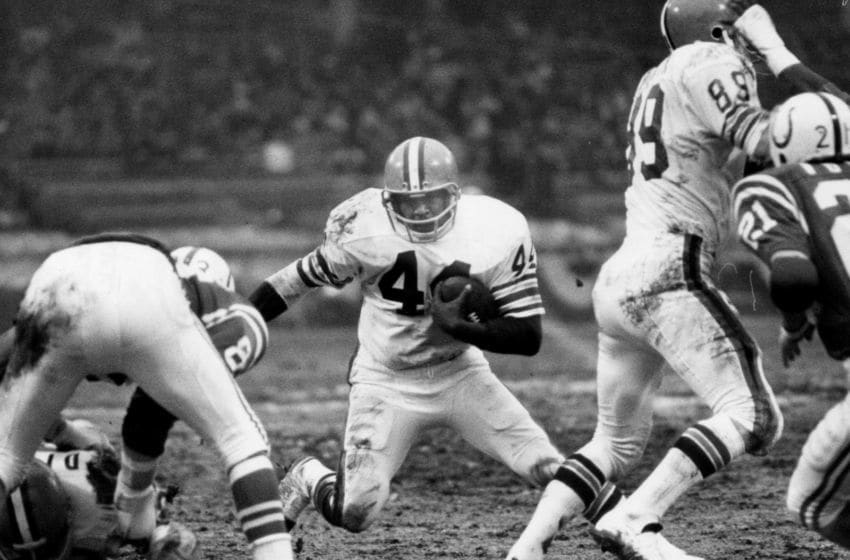Cleveland Browns Hall of Fame running back Leroy Kelly (44) runs through a hole in the defense during the AFC Divisional Playoff, a 20-3 loss to the Baltimore Colts on December 26, 1971, at Cleveland Municipal Stadium in Cleveland, Ohio. (Photo by Tim Culek/Getty Images)