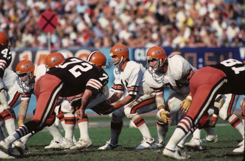 CLEVELAND - OCTOBER 21: Quarterback Ken Anderson #14 of the Cincinnati Bengals takes the ball from center Blair Bush #58 as guard Glenn Bujnoch #74 prepares to block defensive lineman Jerry Sherk #72 of the Cleveland Browns at Municipal Stadium on October 21, 1979 in Cleveland, Ohio. (Photo by George Gojkovich/Getty Images)