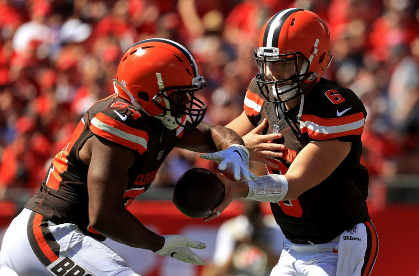 TAMPA, FL - OCTOBER 21: Baker Mayfield #6 hands off to Nick Chubb #24 of the Cleveland Browns during a game against the Tampa Bay Buccaneers at Raymond James Stadium on October 21, 2018 in Tampa, Florida. (Photo by Mike Ehrmann/Getty Images)