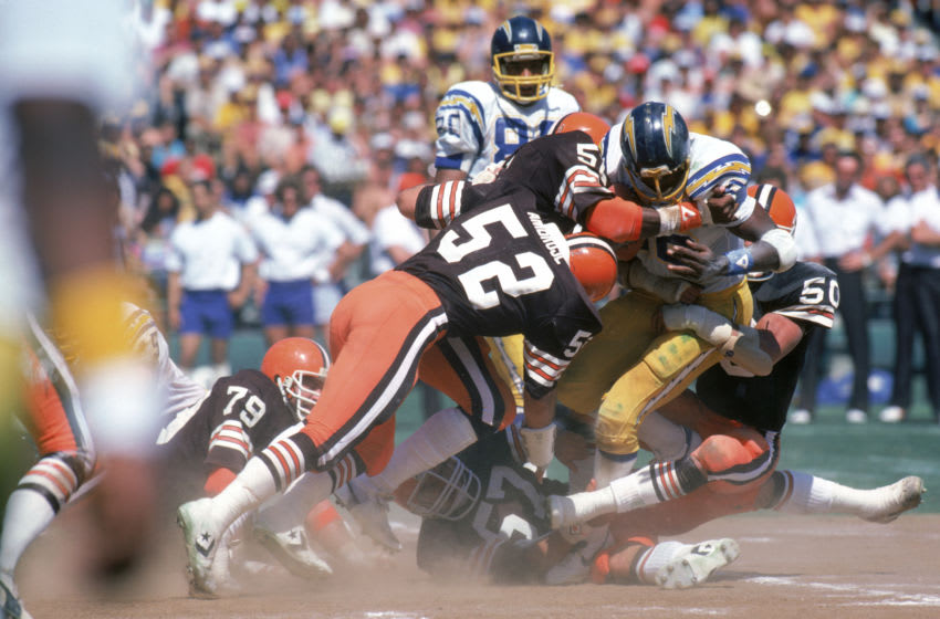 SAN DIEGO - SEPTEMBER 25: Linebackers Dick Ambrose #52 and Tom Cousineau #50, Chip Banks #54 of the Cleveland Browns tackle running back Chuck Muncie #46 of the San Diego Chargers during a game at Jack Murphy Stadium on September 25, 1983 in San Diego, California. The Browns won 30-24 in overtime. (Photo by George Rose/Getty Images)