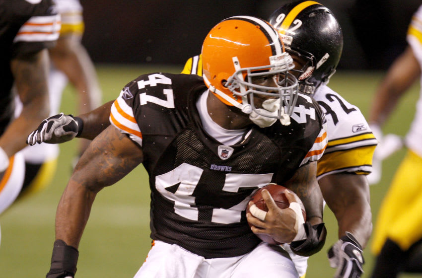 CLEVELAND - SEPTEMBER 14: Lawrence Vickers #47 of the Cleveland Browns tries to get around James Harrison #92 of the Pittsburgh Steelers during a first quarter on September 14, 2008 at Cleveland Browns Stadium in Cleveland, Ohio. (Photo by Gregory Shamus/Getty Images)