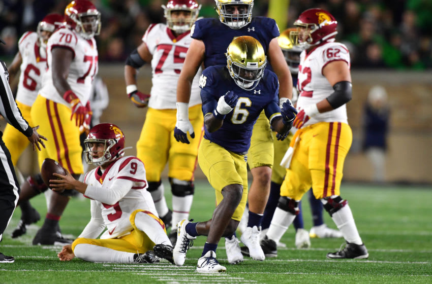 Oct 12, 2019; South Bend, IN, USA; Notre Dame Fighting Irish defensive back Jeremiah Owusu-Koramoah (6) celebrates after sacking USC Trojans quarterback Kedon Slovis (9) in the first quarter at Notre Dame Stadium. Mandatory Credit: Matt Cashore-USA TODAY Sports