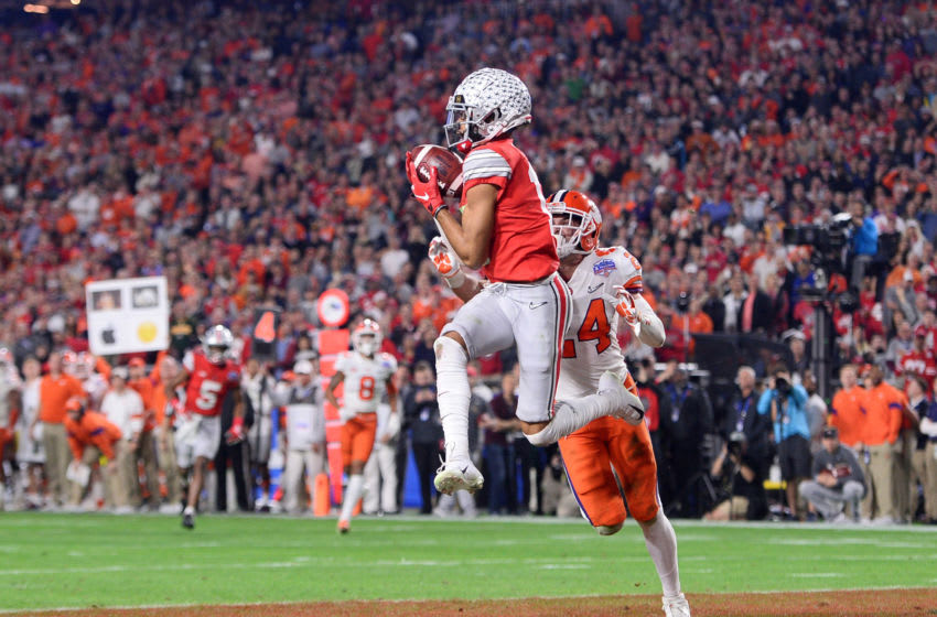 Dec 28, 2019; Glendale, AZ, USA; Ohio State Buckeyes wide receiver Chris Olave (17) catches a pass for a touchdown against Clemson Tigers safety Nolan Turner (24) during the fourth quarter in the 2019 Fiesta Bowl college football playoff semifinal game at State Farm Stadium. Mandatory Credit: Joe Camporeale-USA TODAY Sports