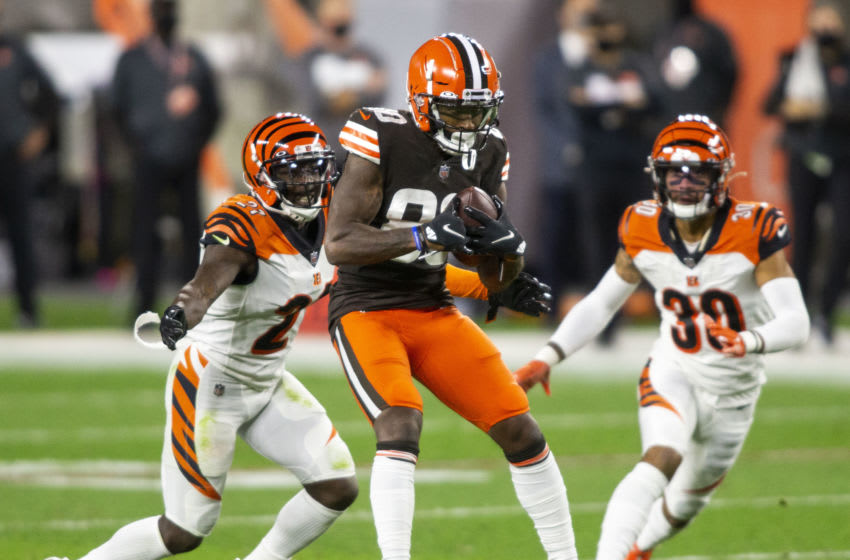 Sep 17, 2020; Cleveland, Ohio, USA; Cleveland Browns wide receiver Jarvis Landry (80) makes a reception under coverage by Cincinnati Bengals cornerback Mackensie Alexander (21) during the second quarter at FirstEnergy Stadium. Mandatory Credit: Scott Galvin-USA TODAY Sports
