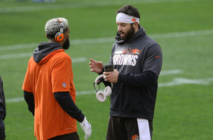 Oct 18, 2020; Pittsburgh, Pennsylvania, USA; Cleveland Browns wide receiver Odell Beckham Jr. (left) and quarterback Baker Mayfield (right) talk on the field before playing the Pittsburgh Steelers at Heinz Field. Mandatory Credit: Charles LeClaire-USA TODAY Sports