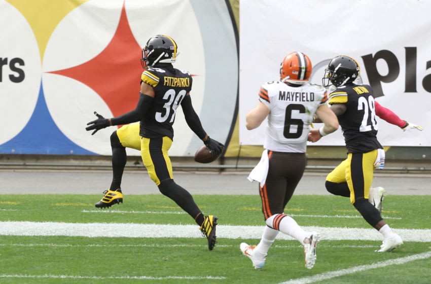 Oct 18, 2020; Pittsburgh, Pennsylvania, USA; Pittsburgh Steelers free safety Minkah Fitzpatrick (39) returns an interception of a Cleveland Browns quarterback Baker Mayfield (6) pass for a touchdown during the first quarter at Heinz Field. Mandatory Credit: Charles LeClaire-USA TODAY Sports