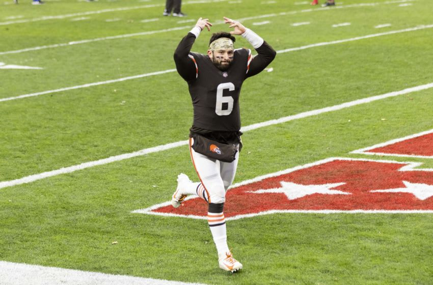 Nov 15, 2020; Cleveland, Ohio, USA; Cleveland Browns quarterback Baker Mayfield (6) signals to fans as he runs off the field following the win against the Houston Texans at FirstEnergy Stadium. Mandatory Credit: Scott Galvin-USA TODAY Sports