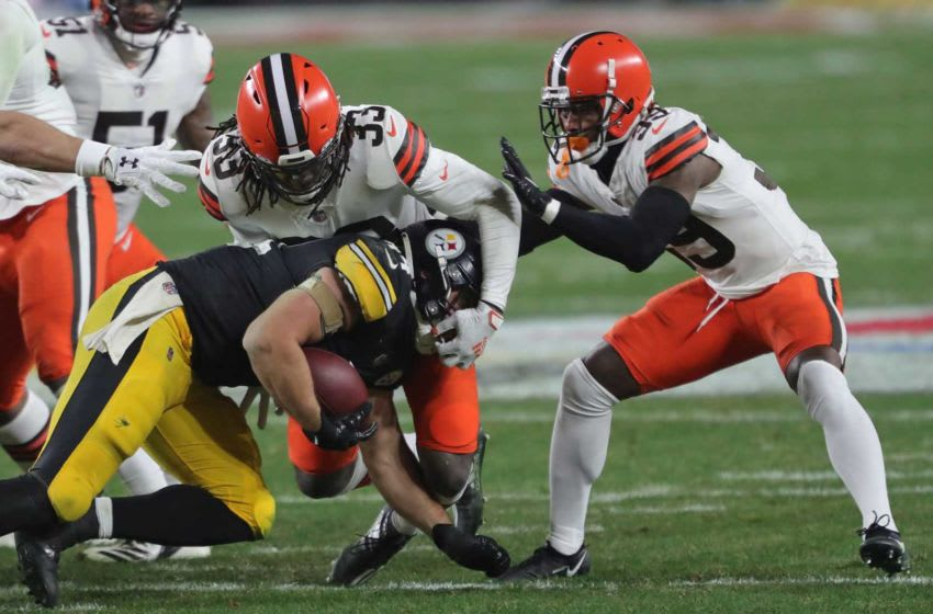 Cleveland Browns strong safety Ronnie Harrison (33) tackles Pittsburgh Steelers fullback Derek Watt (44) after a short gain during the first half of an NFL wild-card playoff football game, Sunday, Jan. 10, 2021, in Pittsburgh, Pennsylvania. [Jeff Lange/Beacon Journal] Browns Extras 23