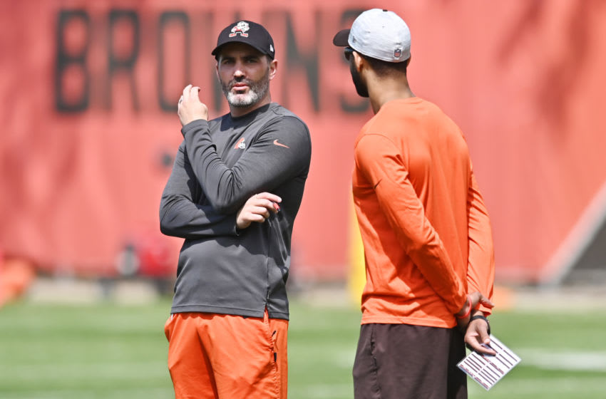 May 14, 2021; Berea, Ohio, USA; Cleveland Browns head coach Kevin Stefanski (left) watches camp with general manager Andrew Berry during rookie minicamp at the Cleveland Browns Training Facility. Mandatory Credit: Ken Blaze-USA TODAY Sports