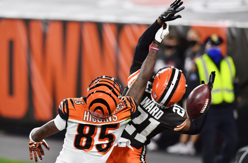 Sep 17, 2020; Cleveland, Ohio, USA; Cincinnati Bengals wide receiver Tee Higgins (85) and Cleveland Browns cornerback Denzel Ward (21) battle for a pass during the second half at FirstEnergy Stadium. Mandatory Credit: Ken Blaze-USA TODAY Sports
