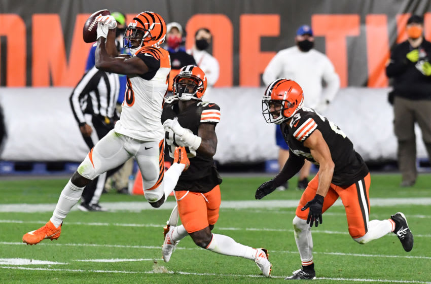 Sep 17, 2020; Cleveland, Ohio, USA; Cincinnati Bengals wide receiver A.J. Green (18) jumps to make a catch in front of Cleveland Browns cornerback A.J. Green (38) and strong safety Andrew Sendejo (23) during the second half at FirstEnergy Stadium. Green dropped the pass. Mandatory Credit: Ken Blaze-USA TODAY Sports