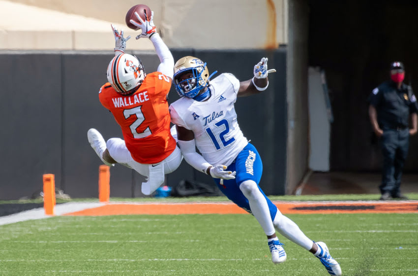Sep 19, 2020; Stillwater, Oklahoma, USA; Oklahoma State Cowboys wide receiver Tylan Wallace (2) makes a catch over Tulsa Golden Hurricane cornerback Allie Green IV (12) during the second half at Boone Pickens Stadium. Mandatory Credit: Rob Ferguson-USA TODAY Sports