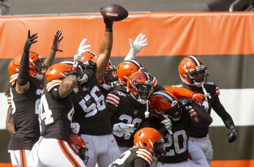 Sep 27, 2020; Cleveland, Ohio, USA; Cleveland Browns outside linebacker Malcolm Smith (56) and teammates celebrate his interception against the Washington Football Team during the second quarter at FirstEnergy Stadium. Mandatory Credit: Scott Galvin-USA TODAY Sports