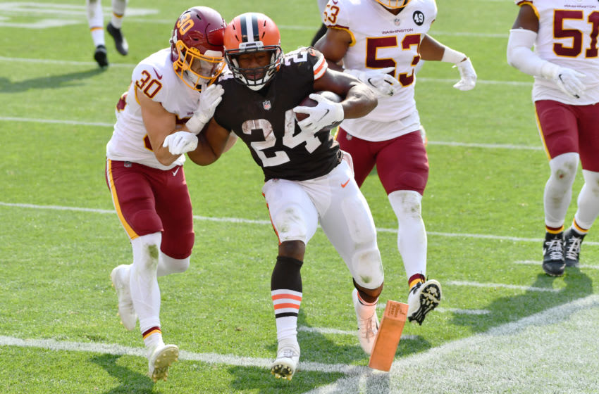 Sep 27, 2020; Cleveland, Ohio, USA; Cleveland Browns running back Nick Chubb (24) scores a touchdown as Washington Football Team free safety Troy Apke (30) defends during the second half at FirstEnergy Stadium. Mandatory Credit: Ken Blaze-USA TODAY Sports