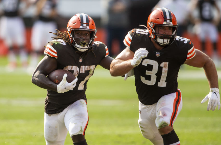 Sep 27, 2020; Cleveland, Ohio, USA; Cleveland Browns running back Kareem Hunt (27) runs the ball as running back Andy Janovich (31) blocks for him against the Washington Football Team during the fourth quarter at FirstEnergy Stadium. The Browns won 34-20. Mandatory Credit: Scott Galvin-USA TODAY Sports