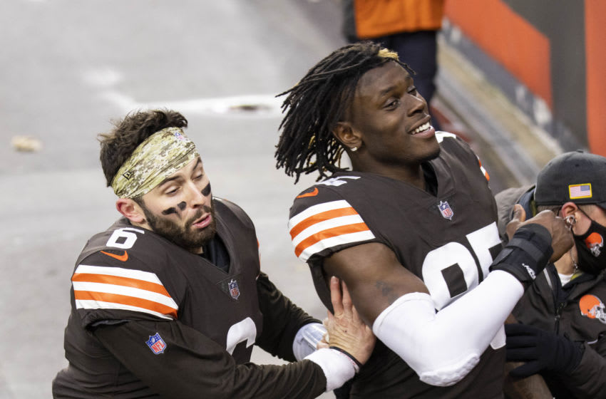 Nov 15, 2020; Cleveland, Ohio, USA; Cleveland Browns quarterback Baker Mayfield (6) runs into tight end David Njoku (85) on his way to the locker room following the game against the Houston Texans at FirstEnergy Stadium. Mandatory Credit: Scott Galvin-USA TODAY Sports