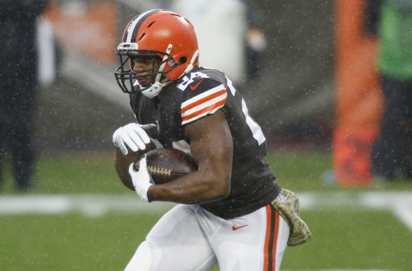 Nov 22, 2020; Cleveland, Ohio, USA; Cleveland Browns running back Nick Chubb (24) runs with the ball during the first quarter against the Philadelphia Eagles at FirstEnergy Stadium. Mandatory Credit: Scott Galvin-USA TODAY Sports