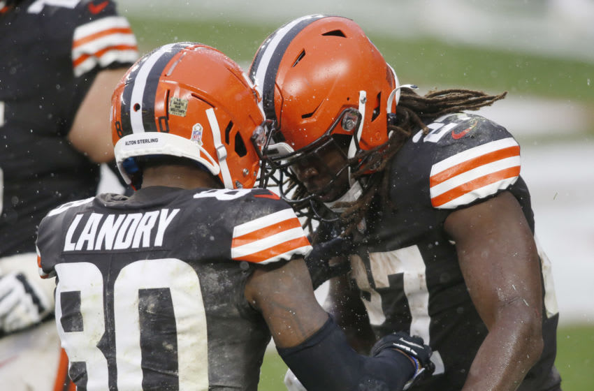 Nov 22, 2020; Cleveland, Ohio, USA; Cleveland Browns wide receiver Jarvis Landry (80) and running back Kareem Hunt (27) celebrate after Hunt scored a touchdown during the second half against the Philadelphia Eagles at FirstEnergy Stadium. Mandatory Credit: Scott Galvin-USA TODAY Sports