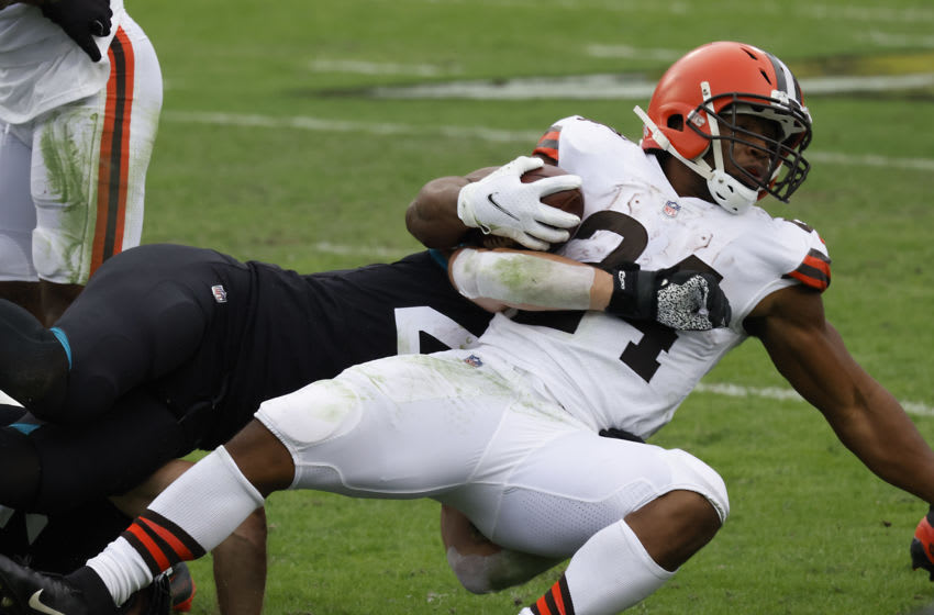 Nov 29, 2020; Jacksonville, Florida, USA; Cleveland Browns running back Nick Chubb (24) is tackled by Jacksonville Jaguars cornerback Josiah Scott (left) during the second quarter at TIAA Bank Field. Mandatory Credit: Reinhold Matay-USA TODAY Sports