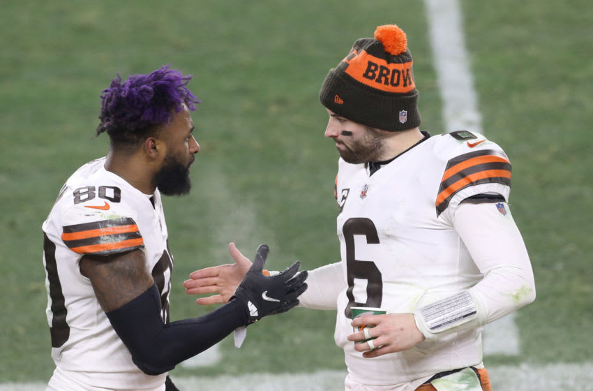Jan 10, 2021; Pittsburgh, PA, USA; Cleveland Browns quarterback Baker Mayfield (6) celebrates with wide receiver Jarvis Landry (80) on the sideline against the Pittsburgh Steelers in the fourth quarter of an AFC Wild Card playoff game at Heinz Field. Mandatory Credit: Charles LeClaire-USA TODAY Sports