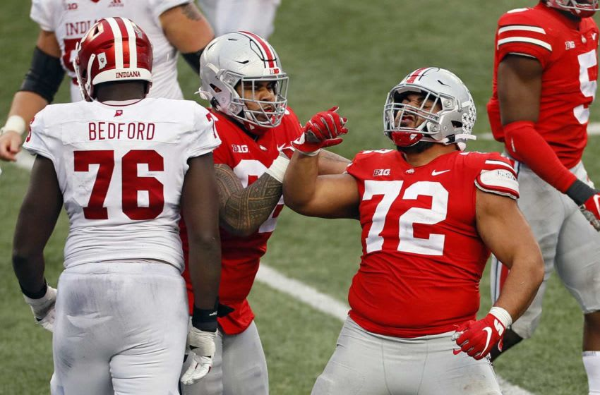 Ohio State Buckeyes defensive tackle Tommy Togiai (72) celebrates a sack with Ohio State Buckeyes defensive tackle Haskell Garrett (92) during the fourth quarter in their NCAA Division I football game on Saturday, Nov. 21, 2020 at Ohio Stadium in Columbus, Ohio. Osu20ind Kwr39