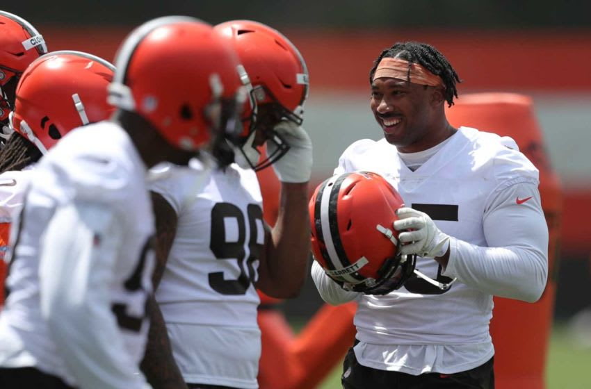 Cleveland Browns defensive end Myles Garrett (95) chats with teammates during an NFL football practice at the team's training facility, Tuesday, June 15, 2021, in Berea, Ohio. [Jeff Lange / Akron Beacon Journal] Browns 11