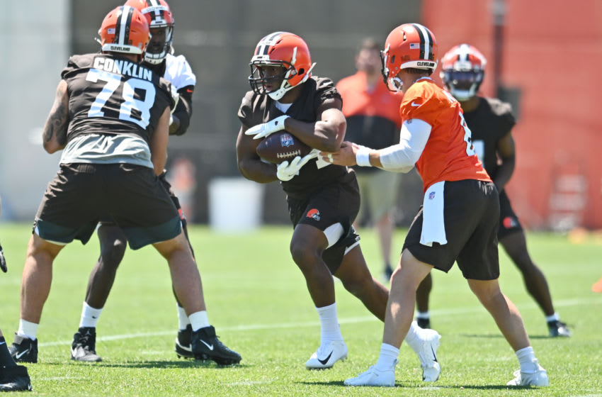Jun 16, 2021; Berea, Ohio, USA; Cleveland Browns quarterback Baker Mayfield (6) hands the ball off to running back Nick Chubb (24) during minicamp at the Cleveland Browns training facility. Mandatory Credit: Ken Blaze-USA TODAY Sports