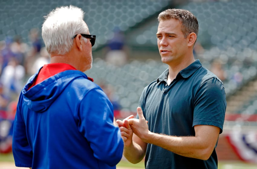 CHICAGO, IL - JULY 03: Chicago Cubs President of Baseball Operations Theo Epstein talks with manager Joe Maddon #70 before the game against the Miami Marlins at Wrigley Field on July 3, 2015 in Chicago, Illinois. (Photo by Jon Durr/Getty Images)