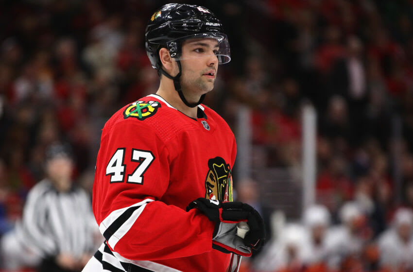 CHICAGO, ILLINOIS - DECEMBER 27: John Quenneville #47 of the Chicago Blackhawks awaits a face-off against the New York Islanders at the United Center on December 27, 2019 in Chicago, Illinois. The Blackhawks defeated the Islanders 5-2. (Photo by Jonathan Daniel/Getty Images)