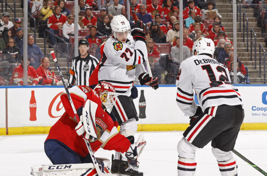 SUNRISE, FL - FEBRUARY 29: Kirby Dach #77 of the Chicago Blackhawks looks down as Goaltender Sergei Bobrovsky #72 of the Florida Panthers stops the shot by Alex DeBrincat #12 at the BB&T Center on February 29, 2020 in Sunrise, Florida. The Blackhawks defeated the Panthers 3-2 in a shootout. (Photo by Joel Auerbach/Getty Images)
