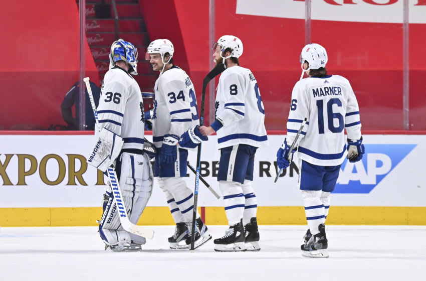 MONTREAL, QC - MAY 25: Auston Matthews #34, Jake Muzzin #8 and Mitchell Marner #16 of the Toronto Maple Leafs congratulate goaltender Jack Campbell #36 on their win over the Montreal Canadiens in Game Four of the First Round of the 2021 Stanley Cup Playoffs at the Bell Centre on May 25, 2021 in Montreal, Canada. The Toronto Maple Leafs defeated the Montreal Canadiens 4-0. (Photo by Minas Panagiotakis/Getty Images)