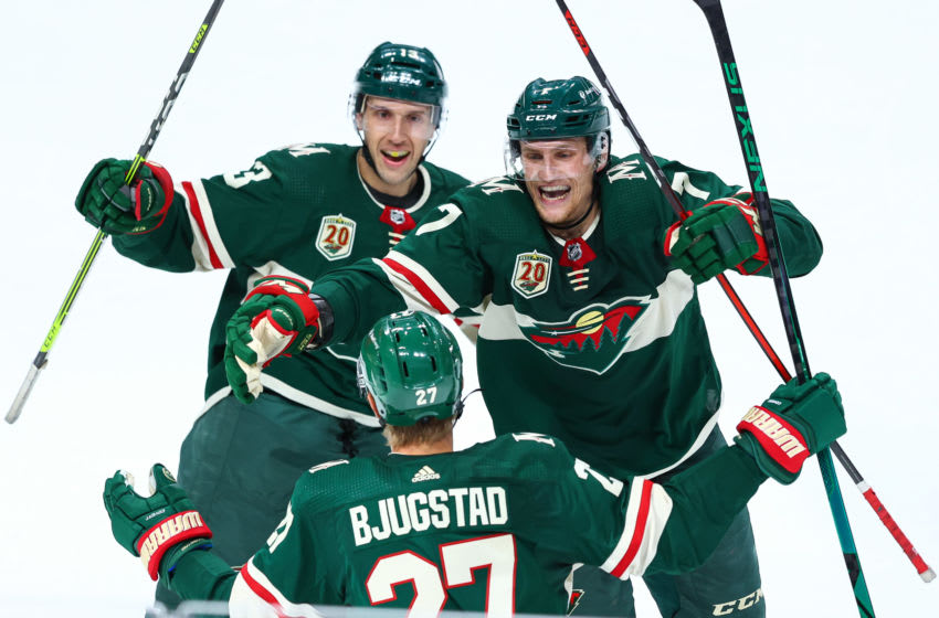 ST PAUL, MN - MAY 26: Nick Bonino #13 and Nico Sturm #7 of the Minnesota Wild celebrate after Nick Bjugstad #27 scores a goal during the third period against the Vegas Golden Knights in Game Six of the First Round of the 2021 Stanley Cup Playoffs at Xcel Energy Center on May 26, 2021 in St Paul, Minnesota. (Photo by Harrison Barden/Getty Images)